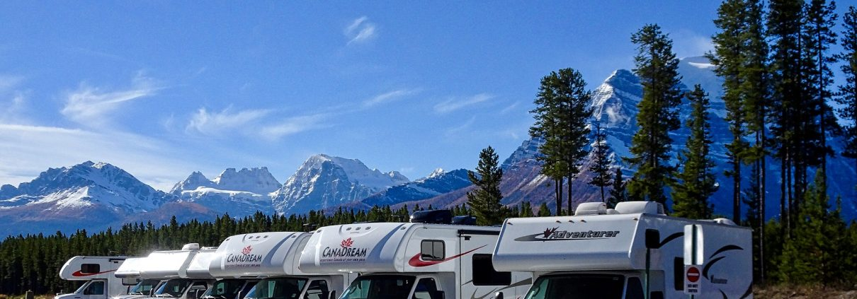 motorhomes in a row with mountains in the background - grey holding tank tips and tricks