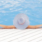 woman relaxing in the pool with a sunhat - let the best rv sewer hose do the work