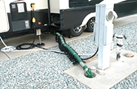 Waste Master RV Sewer Hose Connected to Dump Station
